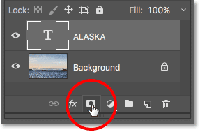 Adding a layer mask to the Type layer in Photoshop.