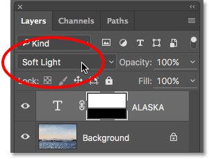 Changing the Type layer's blend mode to Soft Light.