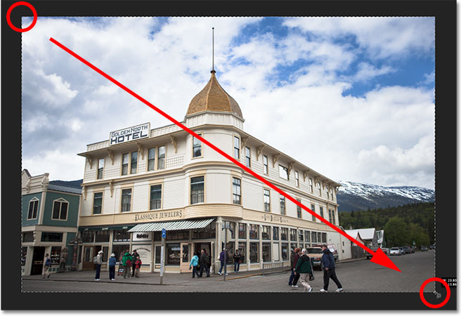 Dragging out a crop box with the Perspective Crop Tool in Photoshop CS6. Image © 2012 Steve Patterson
