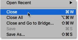 Choosing the Close command under the File menu.