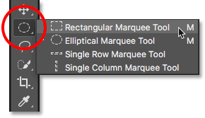 Selecting the default tool from behind the previously selected tool in the Photoshop Toolbar.